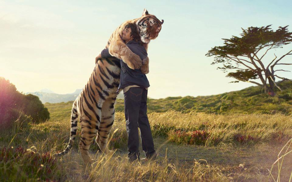 man_and_tiger_hug