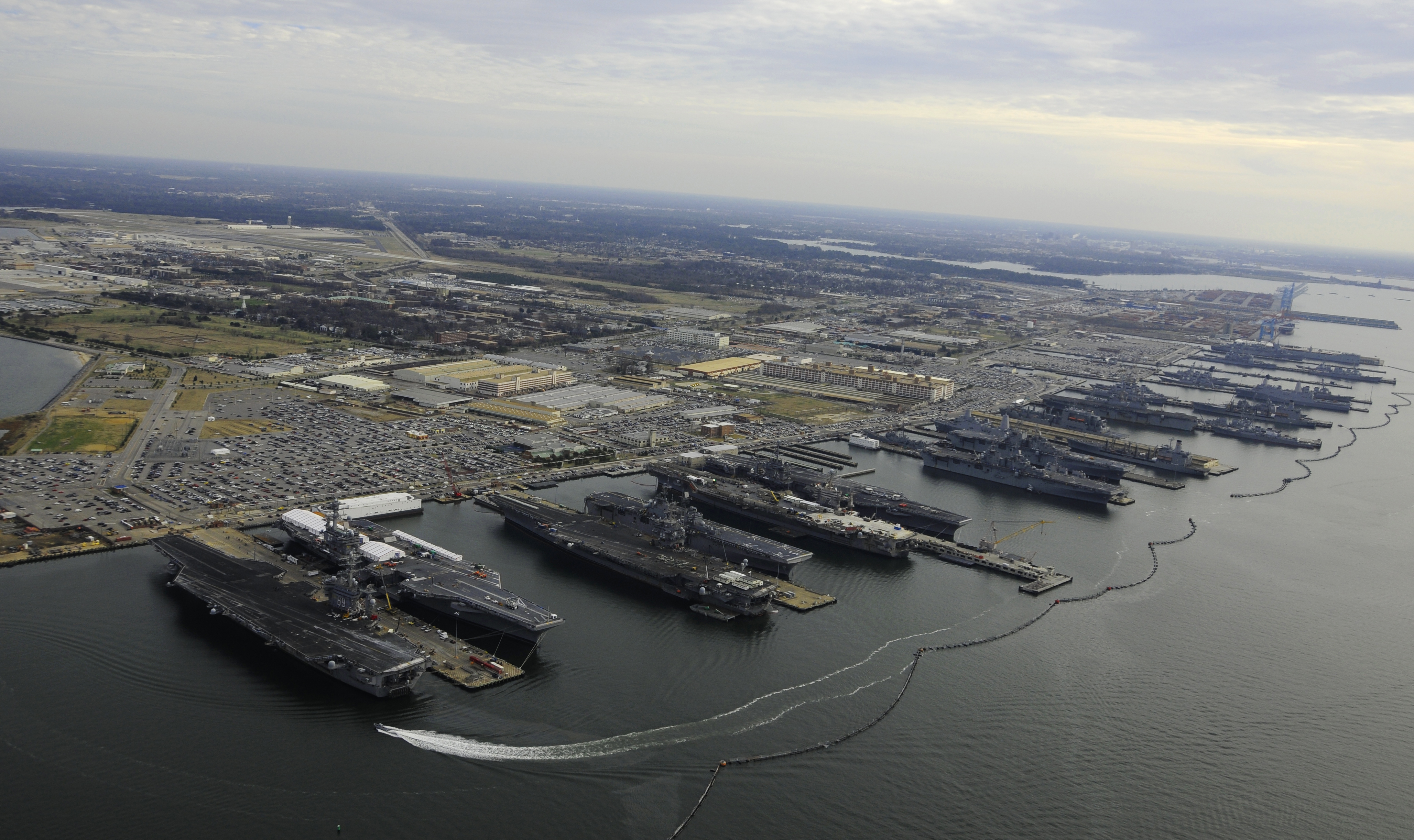 Six amphibious ships and five carriers moored in Norfolk.